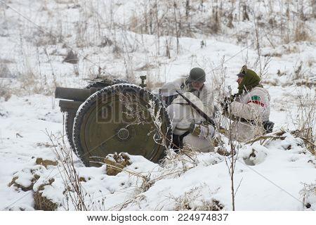 SAINT PETERSBURG, RUSSIA - JANUARY 14, 2018: German artillerymen on the battlefield. Fragment of the military-historical festival