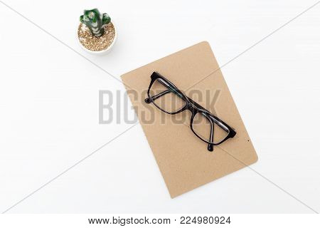 Glasses and notebook on a white background. Mininmalist style