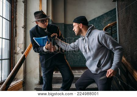 Male bandit with knife attack his victim