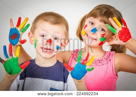 Little Smiling Children With Hand Painted In Colorful Paints