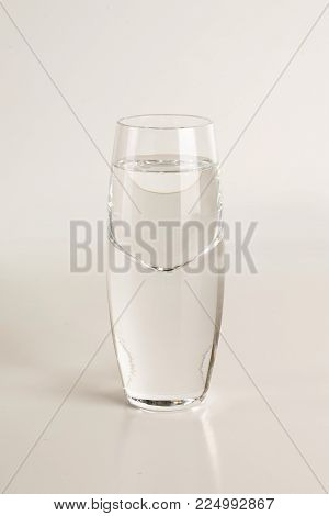 Beautiful glass of vodka on isolated on light gray background