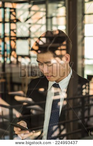 Young Asian Bussiness Man Have A Happy Time With His Job, Love Working