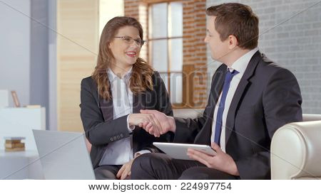 Man and woman business partners shaking hands, concluding agreement, deal HD