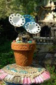 This unusual flower pot and flowers is part of the Ave Maria Grotto in Cullman, Alabama. poster
