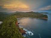 Ocean bay in sunset time aerial drone view. Nicaragua travel landscape poster