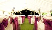 Tables and chairs inside a wedding marquee poster