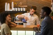 African american man and woman flirting talking at bar counter, black couple enjoying drinks and pleasant conversation on first date in cafe, young guy with lady having fun at meeting in coffee house poster