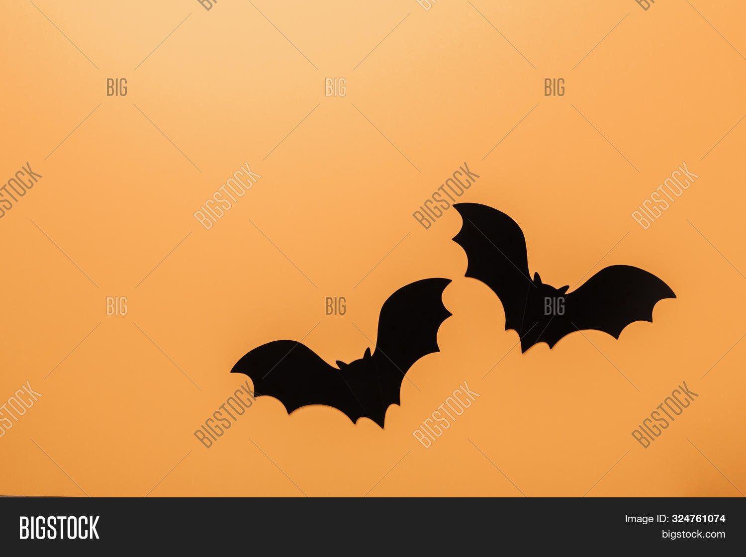 Halloween Decorations Concept. Black Paper Bats On Orange Background. Top View Copy Space - Image