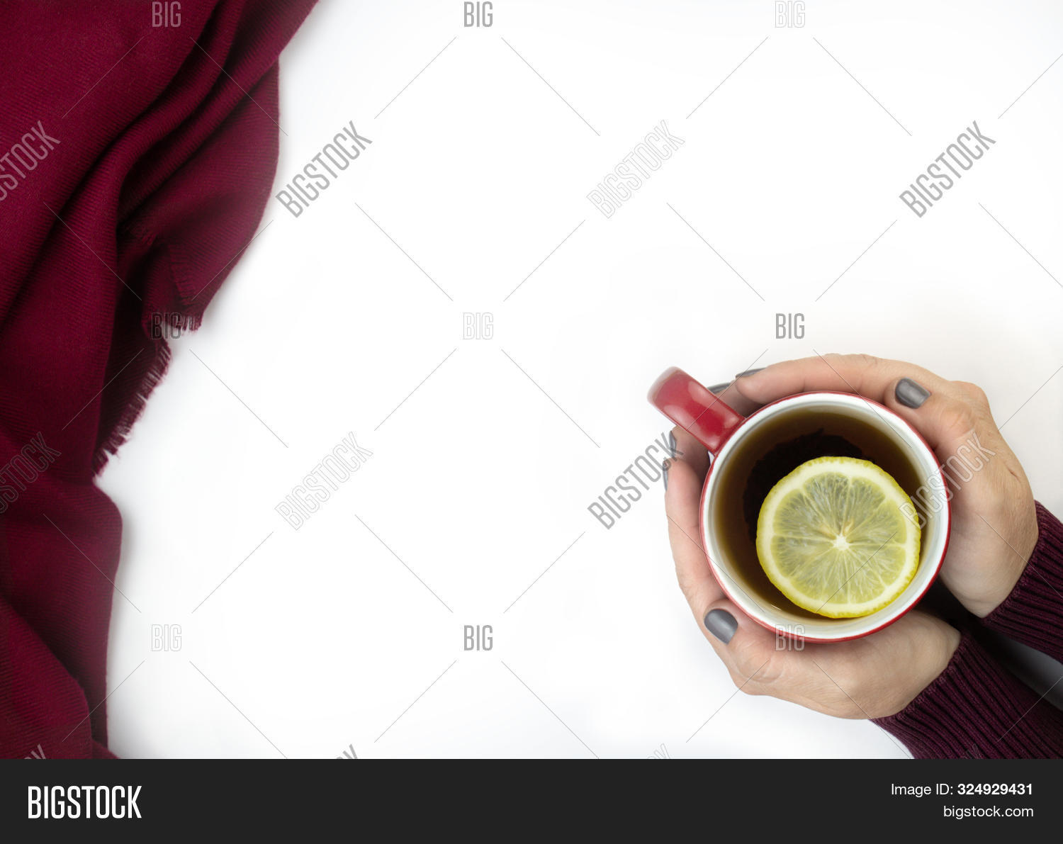 Female Hands Holding Red Cup Of Tee With Limon Slices. Seasonal Autumn Or Winter Warming Drink. Chri
