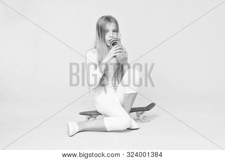 Trendy Girl. Girl Having Fun With Penny Board Pink Background. Kid Adorable Child Long Hair Adore Ri