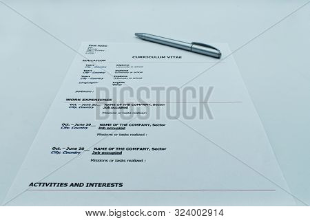 Resume, Curriculum Vitae, Ready To Be Filled Out With A Pen, On White Background