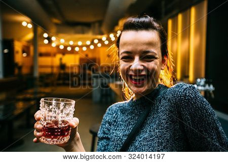 Drunk Brunette Student Woman Alone In Happy Smiling Face Expression Holding And Looking Thoughtful T