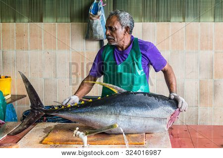 Male, Maldives - November 16, 2017: Man Prepares Fresh Fish (big Tuna) For Sale At The Fish Market I
