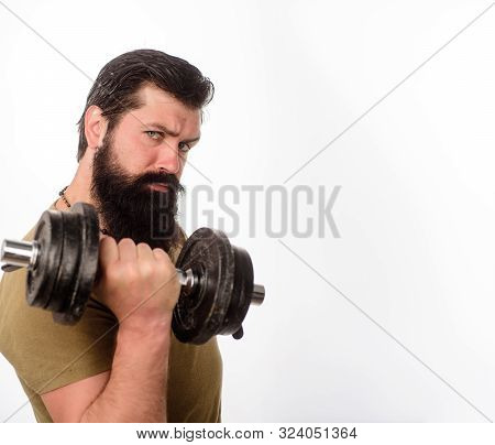 Bearded Man With Dumbbell During An Exercise. Fitness Man With Dumbbell In Gym. Strong Handsome Spor