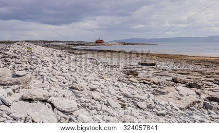 View Of The Empty Limestone Rocky Beach Of Inis Oirr Island With The Sea And The Plassey Shipwreck I