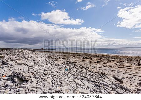 Empty Limestone Rocky Beach Of The Island Of Inis Oirr With The Atlantic Ocean And The Plassey Shipw