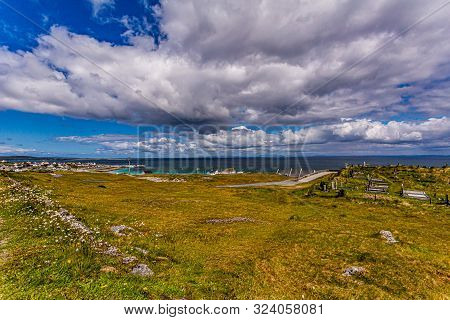 View Of The Irish Countryside With Graves On The Hill, The Small Town Of The Island Of Inis Oirr Wit