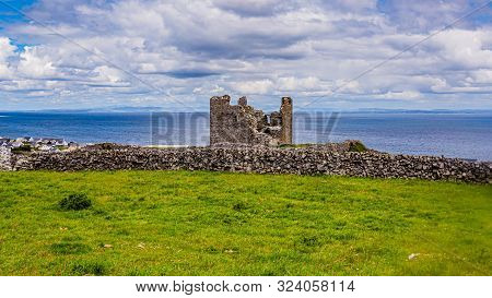 View Of The Ruined Castle Tower (caisleán Ui Bhriain) On Inis Oirr Island, The Village And The Atlan