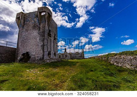 Ruined 19th Century Tower (a Túr Faire) In Inis Oirr Island, Wonderful Sunny Day With A Blue Sky And