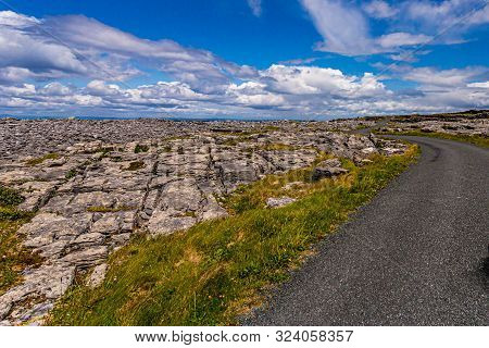 Stunning View Of A Road Next To The Rocky Limestone Coast On Inis Oirr Island, Wonderful Sunny Day W