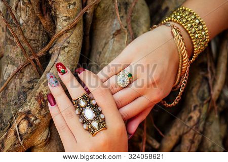 Hands Of An Indian Woman Decorated With Costume Jewelry In Goa , India. Close Up