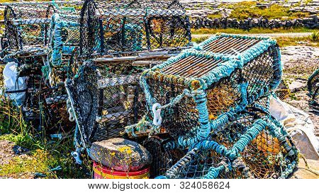 Old Lobster / Crab Cages Or Fishing Traps Lying By The Garbage On The Coast Of The Island Of Inis Oi