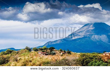 View Of A House On A Sunny Day With The Volcano Of Colima In The Background In The State Of Jalisco