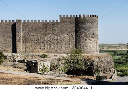 Black Basalt Wall Of Fortress Fortifications With Battlements In The City Jf Dyarbakir, The Capital