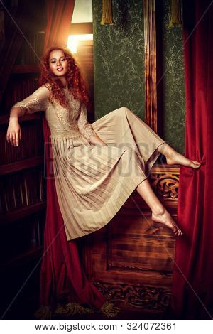 Beautiful romantic girl in a light lace dress in a vintage interior. Fairy tales. Young princess in a castle.