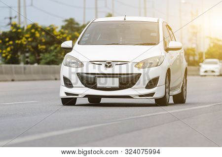 Bangkok, Thailand - August,13: Mazda 2 White Car Running On The Road. On August,13,2018 In Bangkok,