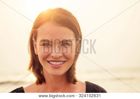Woman, 30-35 Years Old Smiling Toothy Smile With Braces On Sea Ocean Beach Background.spf And Sunscr