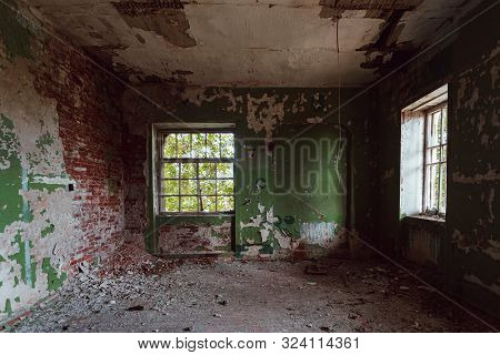 Interior Of Messy Dirty Room At Old Abandoned Building.