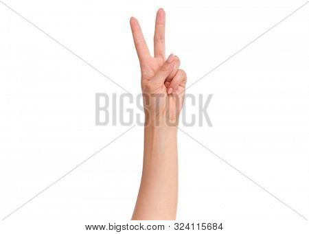 Female hand showing 2 fingers or Victory gesture, isolated on white background. Beautiful hand of woman with copy space. Hand doing gesture of number Two. Series of photos count from 1 to 5.