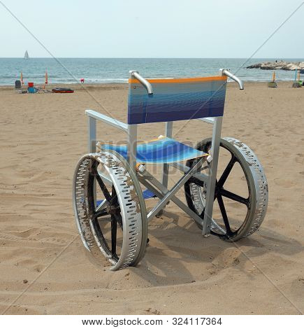 Wheelchair With Big Wheels Made With Alloy Of Aluminium To Move On The Sandy Beach On Summer Without