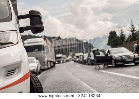 Typical Scene On European Highways During Summer Holiadays Rush Hour. A Traffic Jam With Rows Of Car