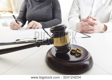 Divorce Concept. Hands Of Wife, Husband Signing Decree Of Divorce, Canceling Marriage, Legal Separat