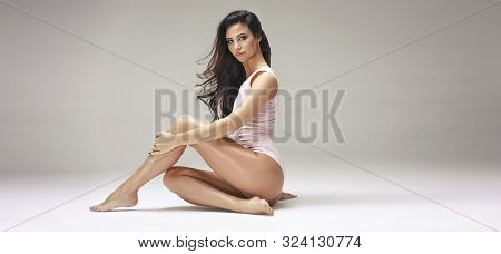 Perfect Slim Toned Young Body Of Brunette Sensual Girl, Fit Woman At Studio. The Fitness, Diet, Spor