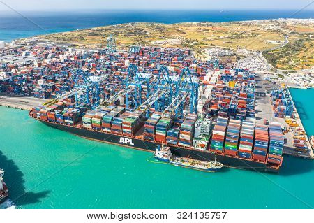 Huge Apl Cargo Ship For Transporting Containers In Port At Unloading. Malta, Il Brolli Marsaxlokk, M