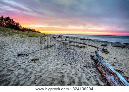 Lake Superior Sandy Beach Sunset.  Beautiful Sunset Horizon On The Remote Beach Of Whitefish Point O