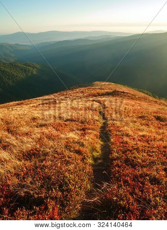 Mountain Trail, Hiking Road On Sunset Sky Background, Travel And Toursm In The Wild Nature