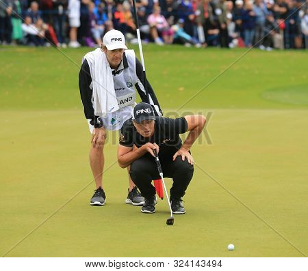 VIRGINIA WATER, ENGLAND. 22 SEPTEMBER 2019: Viktor Hovland lines up a putt during round four of the BMW PGA Championship, European Tour Golf Tournament at Wentworth Golf Club