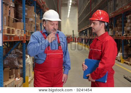 Workers Solving Problem In Warehouse