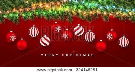Festive Christmas Or New Year Background. Christmas Fir-tree Branches With Light Garland And Xmas Re