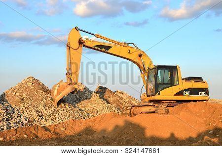 Minsk, Belarus 04/30/2019: Heavy Excavator Caterpillar 318 C L In A Working At Construction Site Unl