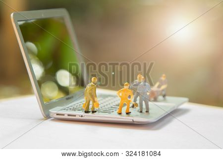 Miniature Worker People Or Small Figure Cleaning Computer Maintenance Model As Electronic Repair And