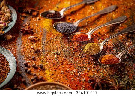 Bright Seasonings Scattered On Table. Spices Still Life
