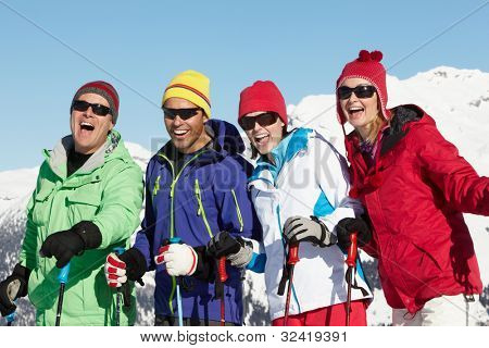 Group Of Middle Aged Couples On Ski Holiday In Mountains poster