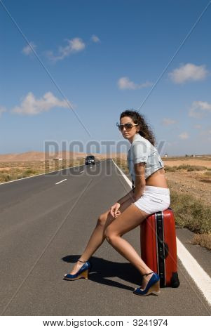 Woman In The Road Auto-Stop Under The Blue Sky