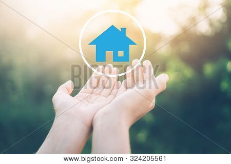 Woman Open Hand Up To Sunset Sky And Green Blur Leaf Bokeh Sun Light With Home Icon Abstract Backgro