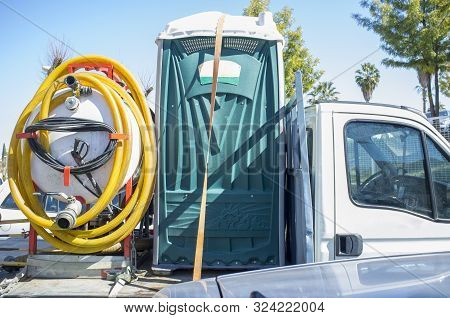 Portable Toilet With Pump Loaded Over Small Truck. Outdoors Shot